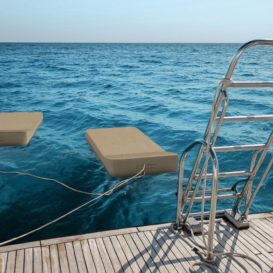 MrBlueSky Jackie floating lounge behind boat