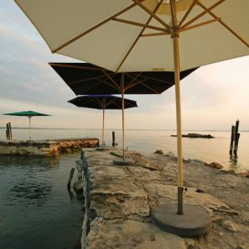 weishaupl teak umbrella near the ocean_opt
