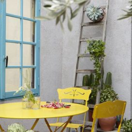 Fermob bagatelle chair yellow in nice setting